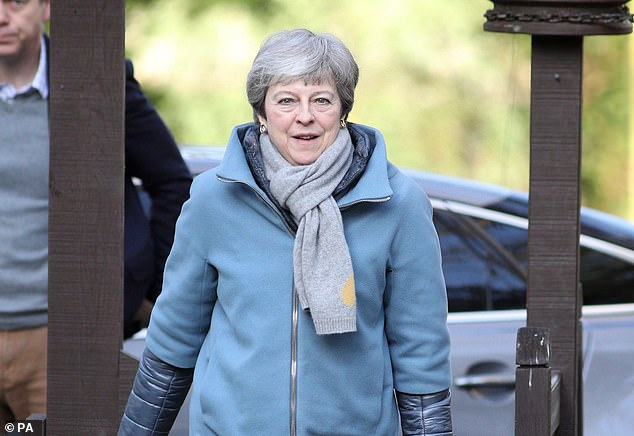 Theresa May has warned Eurosceptics including Boris Johnson and David Davis that if they refused to get behind her plan, MPs would force through a 'soft' Brexit