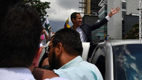 Opposition leader Juan Guaido returns to Venezuela, risking arrest