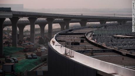 China cuts taxes as it warns of 'a hard struggle' ahead