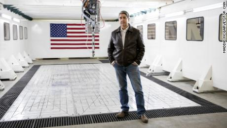 Michael Garvey, CEO of M7 Technologies, stands next to one of the biggest 3D printers in the world in Youngstown, Ohio.