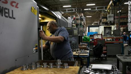 Larry McRae, a CNC machinist, works on the floor of Jergens, a manufacturing efficiency company in Cleveland.