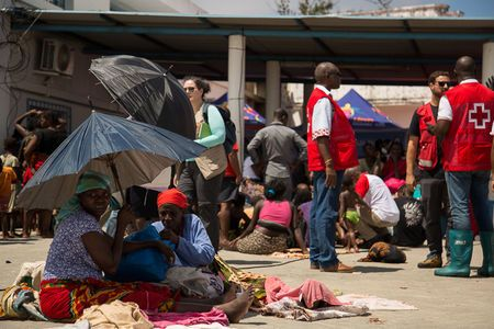 Survivors of Cyclone Idai, are seen after arriving to an evacuation centre in Beira, Mozambique, March 21, 2019. Denis Onyodi/Red Cross Red Crescent Climate Centre/Handout via REUTERS