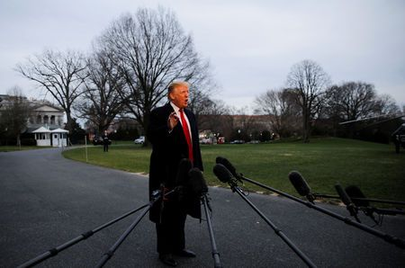U.S. President Donald Trump speaks to reporters as he returns to the White House in Washington