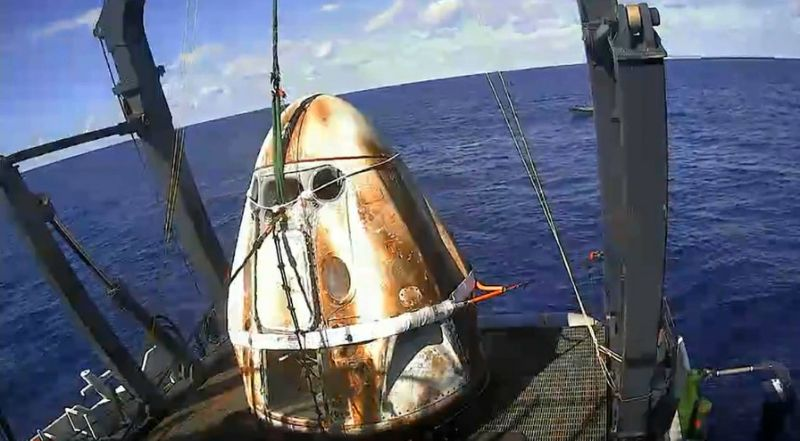 This still image taken from NASA TV shows SpaceX's Crew Dragon spacecraft safely aboard the company's recovery vessel following splashdown on March 8, 2019 (AFP Photo/HO)