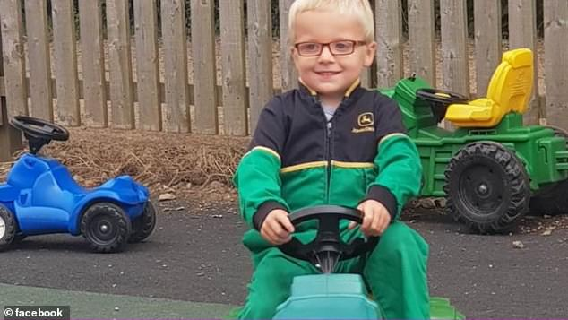 The now five-year-old (pictured) was never expected to walk or talk due to the extent of his problems, which includebowel issues, anxiety, autism and allergies to name a few. But the youngster has defied all expectations and even attends a mainstream school