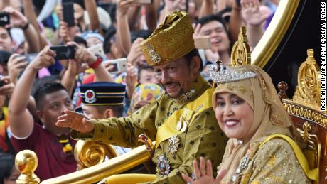 Brunei's Sultan Hassanal Bolkiah and Queen Saleha pictured during his golden jubilee in Bandar Seri Begawan on October 5, 2017.