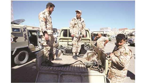 Air strike halts Tripoli flights as thousands flee Libya clashes