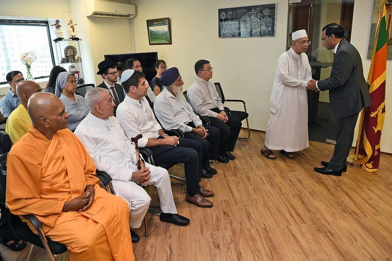 Religious leaders in Singapore pay their respects to victims