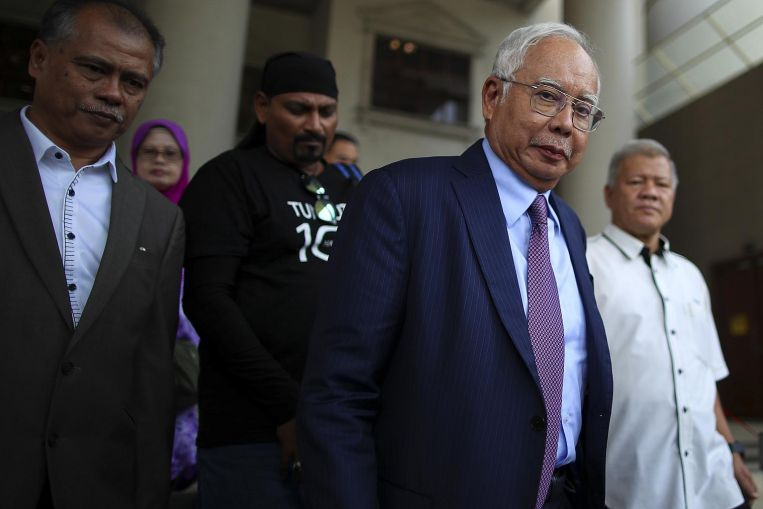 Malaysia's High Court dismisses Najib's application to strike out charges, corruption trial to go on