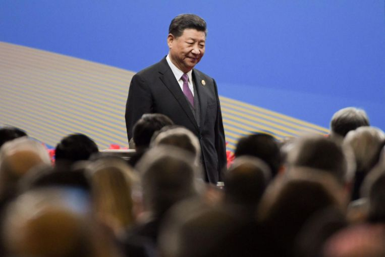 China's President Xi Jinping defends Belt and Road, says 'not exclusive club'
