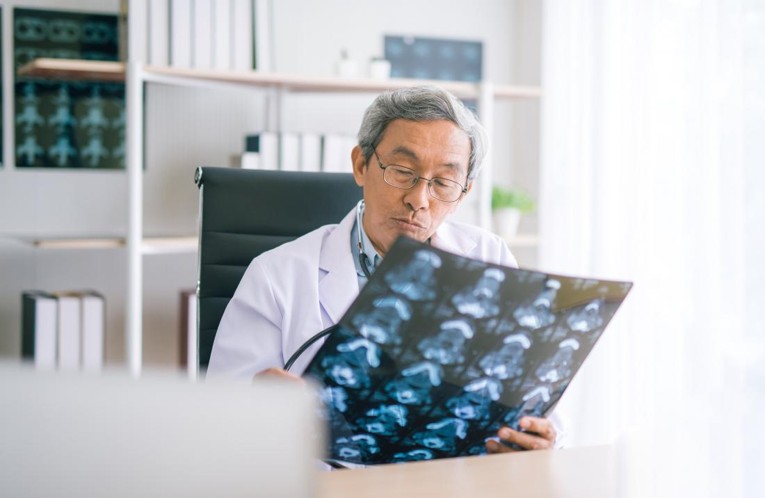 doctor looking at chest xrays