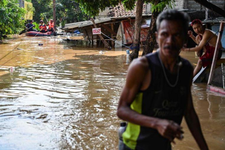 Torrential rain triggers flooding, evacuations in Jakarta