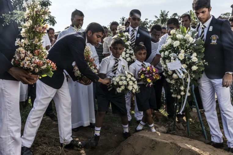 Death toll in Sri Lankan bombings rises to 359, police arrest another 18 suspects