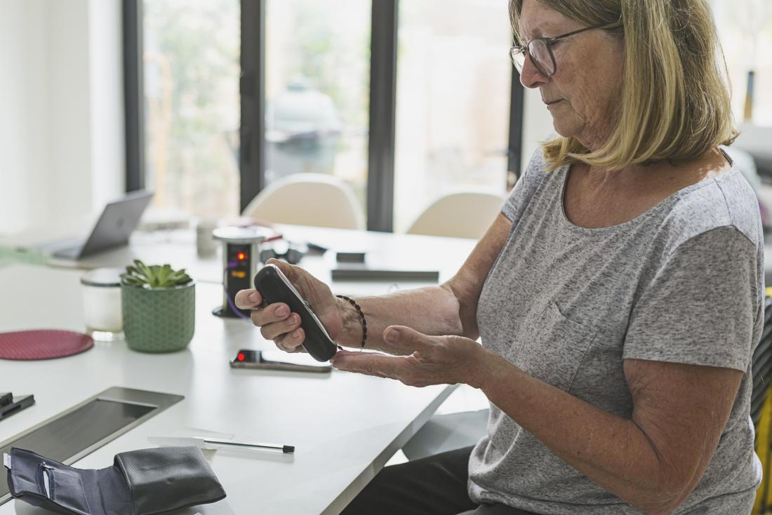 woman checking cholesterol measurements