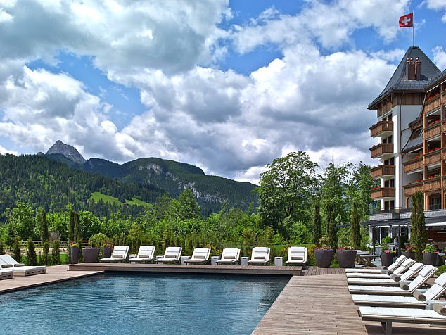 Swish: The heated outdoor pool of The Alpina, which sits amid the magnificent Swiss Alps