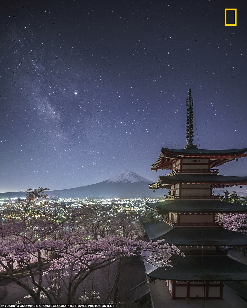 Yukihito Ono took this stunning image in the Japanese city of Fujisawa. He said: 'I was able to see the Milky Way when the cherry blossoms at Chureito Pagoda were in full bloom and I was able to shoot this rare landscape'