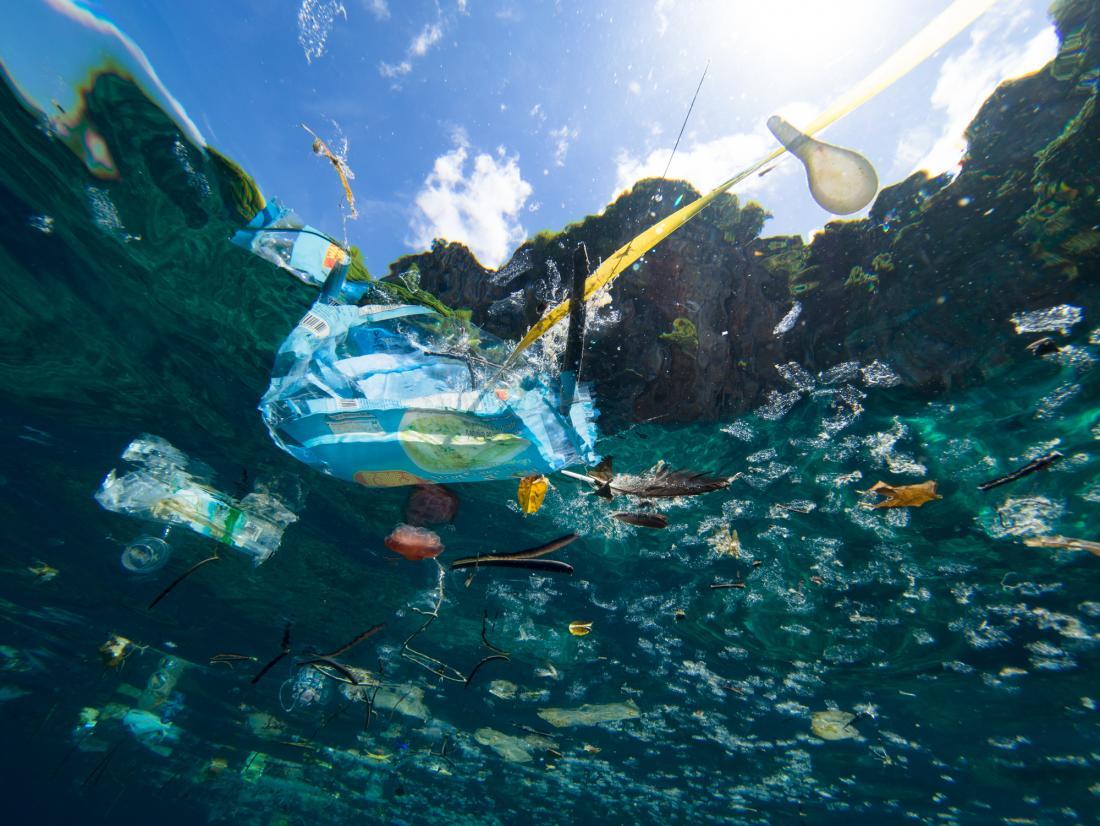 shot of plastic bag and bottles in ocean