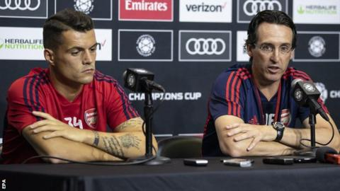 Granit Xhaka and Unai Emery at a news conference in the United States