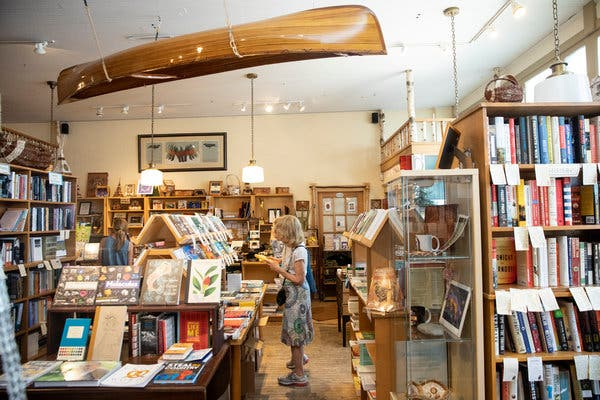 A handcrafted canoe hangs from Birchbark's ceiling.