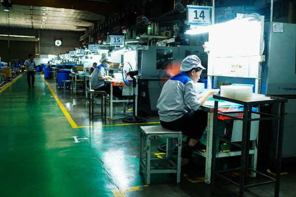 Workers at Bac Viet Technology in Bac Ninh. The company produces small plastic parts for Canon, Korg and Samsung.