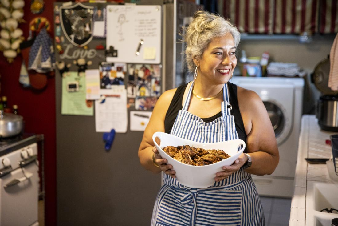 overweight woman smiling holding food