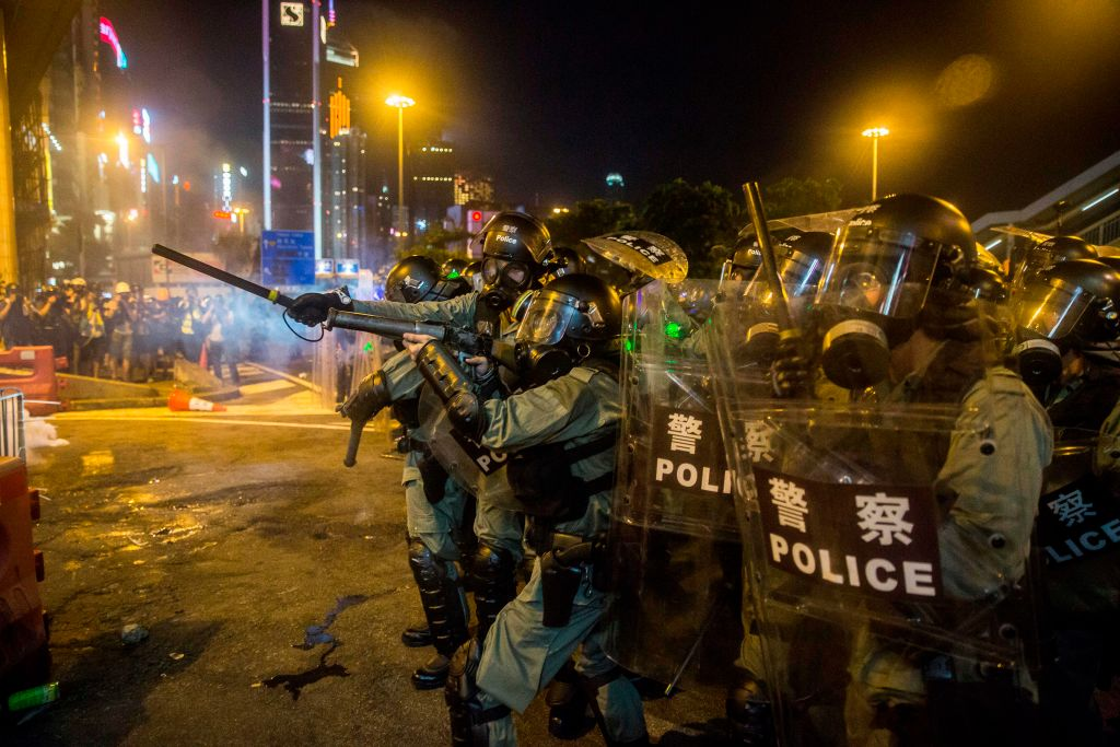 Police fire tear gas during a protest in the district of Causeway Bay in Hong Kong
