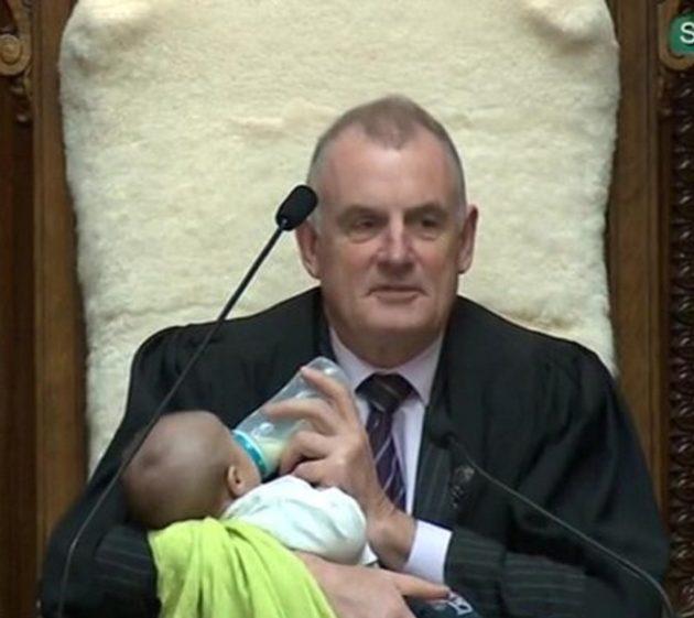 Speaker of New Zealand's Parliament Cradles Legislator's Baby During a Vigorous Debate