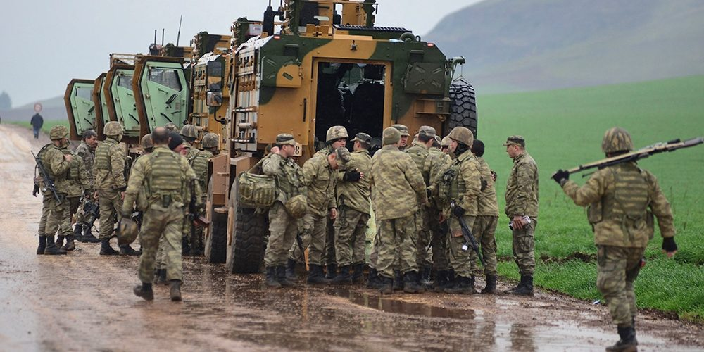 Syria Accuses Turkish Convoy Helping Armed Rebel Groups Fighting a Government Advance