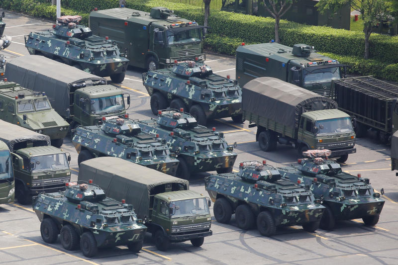 Thousands of Chinese Military Personnel Parade Seen Near Hong Kong Border