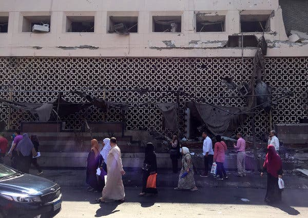 Outside the National Cancer Institute in Cairo on Monday, after a blast from a car loaded with explosives destroyed the hospital's facade.