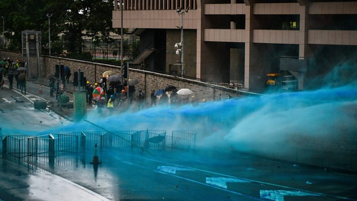 Hong Kong Police Use Tear Gas To Disperse Demonstrators Who Defy Ban on March
