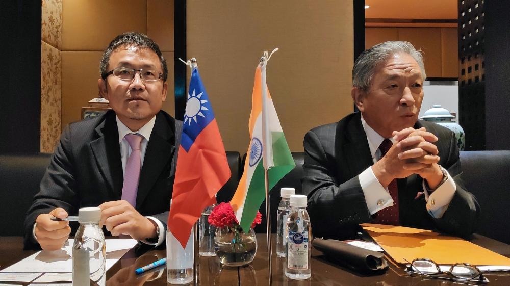 Shih-Chung Liu and Chung-Kwang Tien attend a news conference in New Delhi