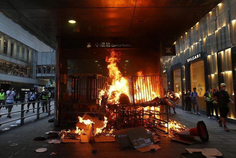 Hong Kong Police Ban Mass March After Demonstrators Set Fire to a Subway Station