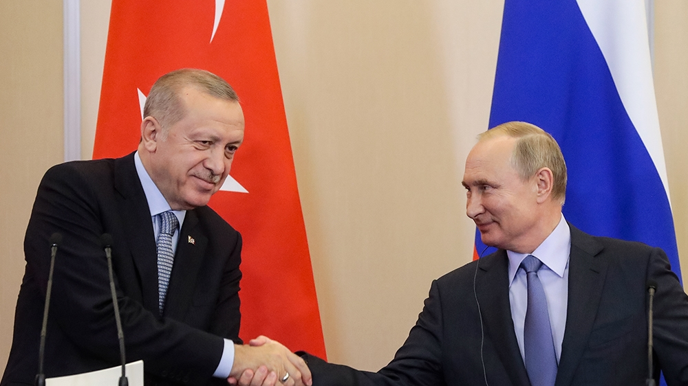 Russian President Vladimir Putin, right, and Turkish President Recep Tayyip Erdogan shake hands after their joint news conference following their talks in the Bocharov Ruchei residence in the Black Se
